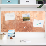 Love this Scandinavian workspace makeover with white open shelves, plenty of storage for craft supplies, and a gorgeous DIY copper inspiration board.