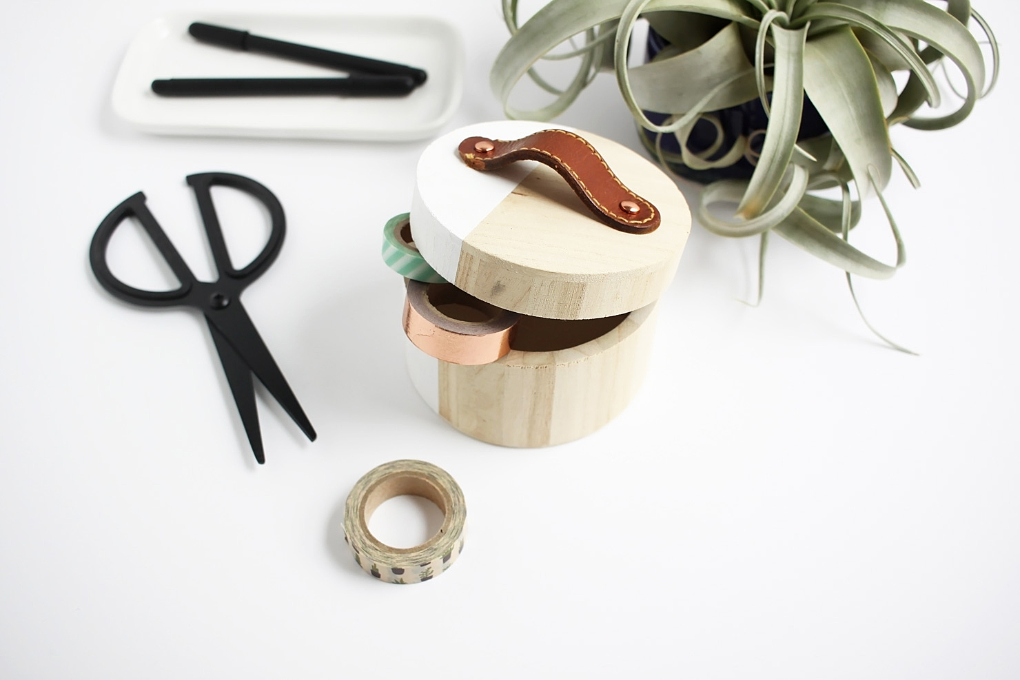 Turn a thrifted leather belt into a simple handle for a modern storage box. Perfect for your favorite washi tape.