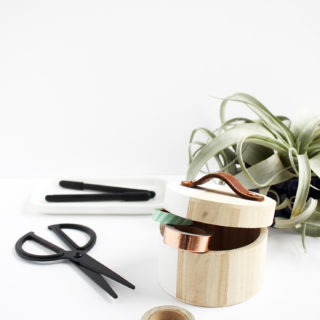 Make a leather handle for these modern storage boxes using thrifted belts.
