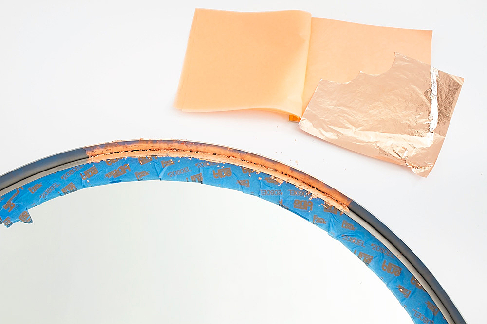 You can turn any plain mirror into a DIY copper mirror on a budget using just copper leaf and a paintbrush. The perfect inexpensive craft for a high-end look!