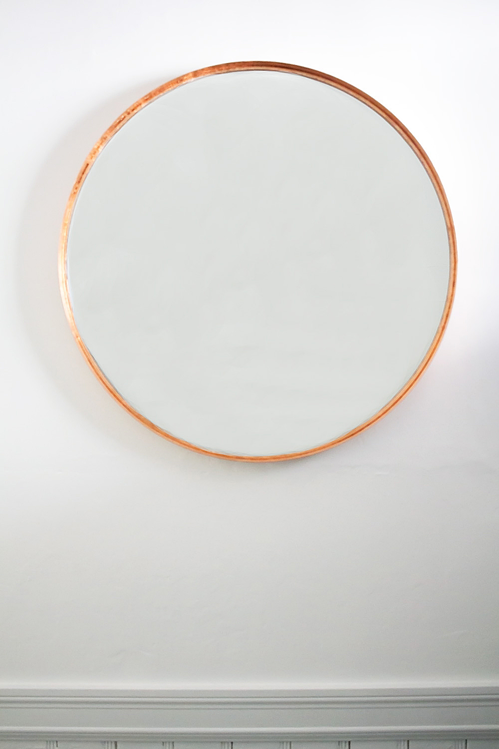 You can turn any plain mirror into a DIY copper mirror on a budget using just copper leaf and a paintbrush. The perfect low-budget craft for a high-end look!