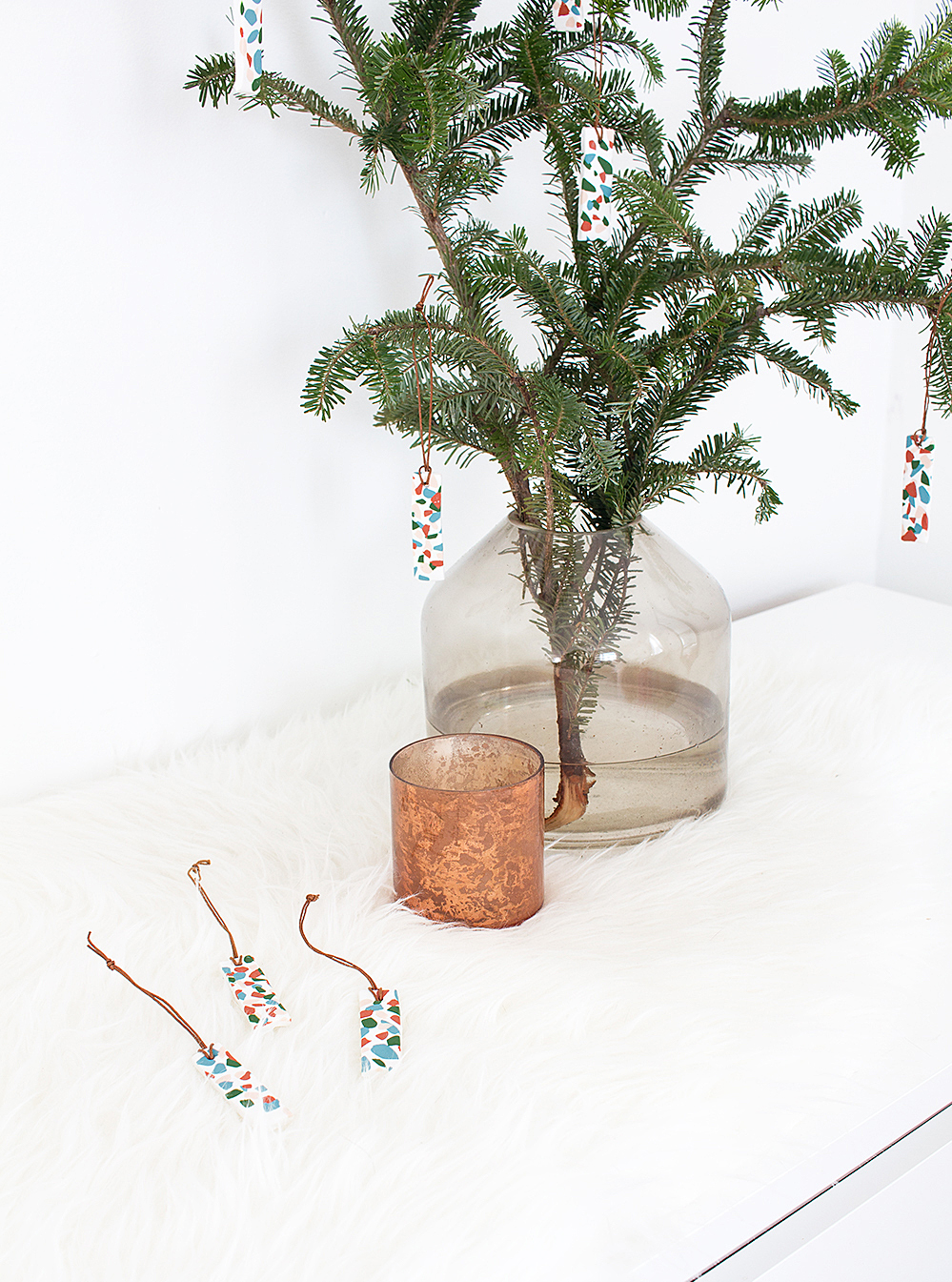 Make these easy and fun DIY terrazzo tile ornaments for a modern, colorful addition to your holiday decor.