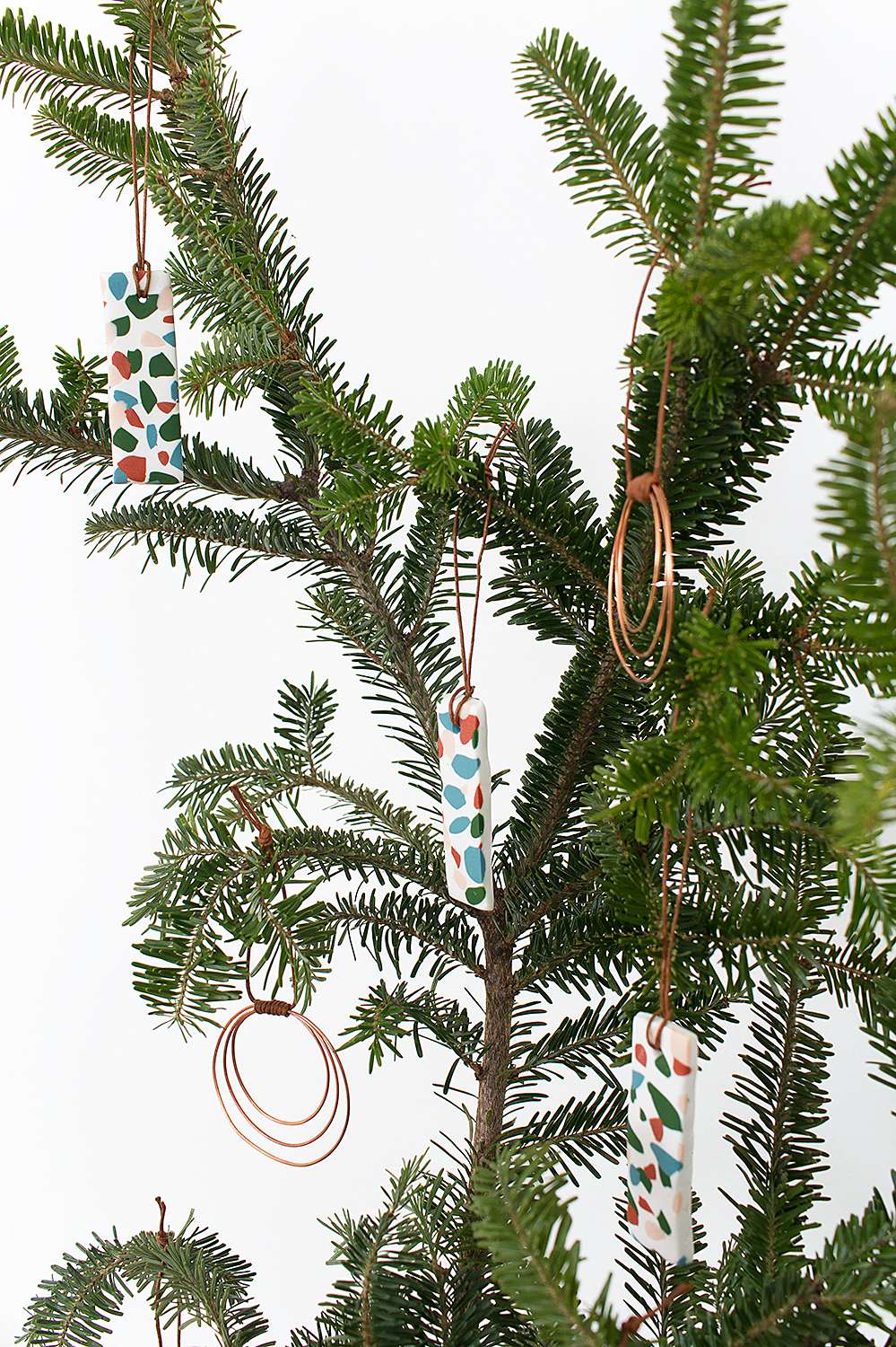 Add a little boho bling to your holiday decor with these easy DIY Copper Wire Hoop Ornaments that take just ten minutes to make!