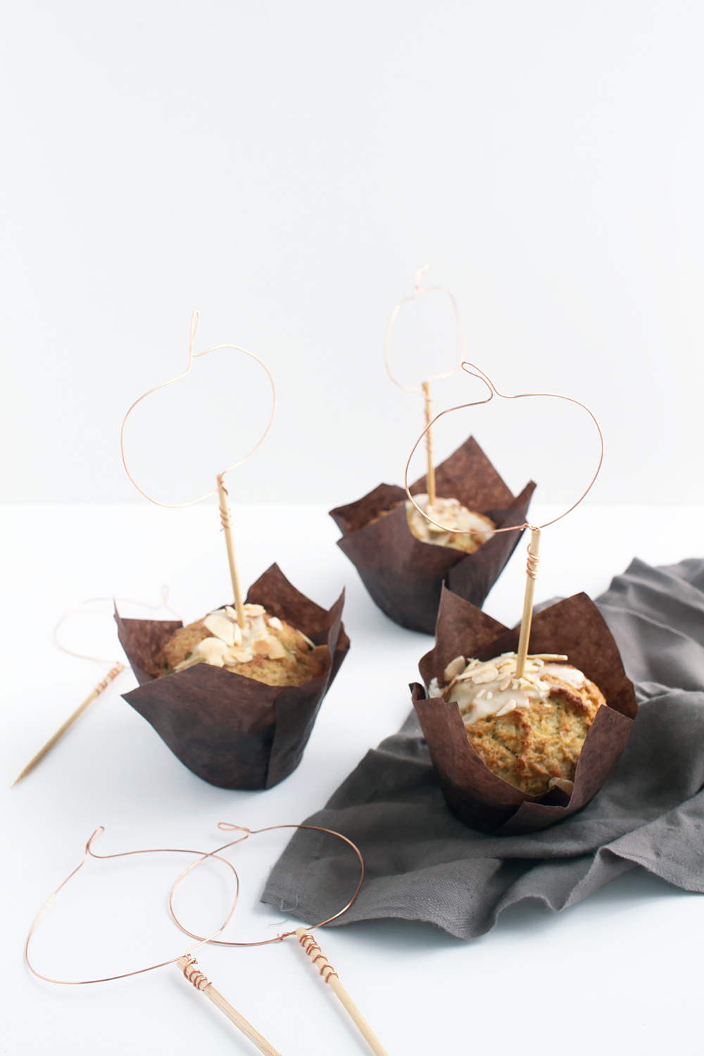 These DIY Wire Pumpkin Cupcake Toppers come together fast in just 4 steps with 2 materials, so you can get back to what's important: eating cupcakes.