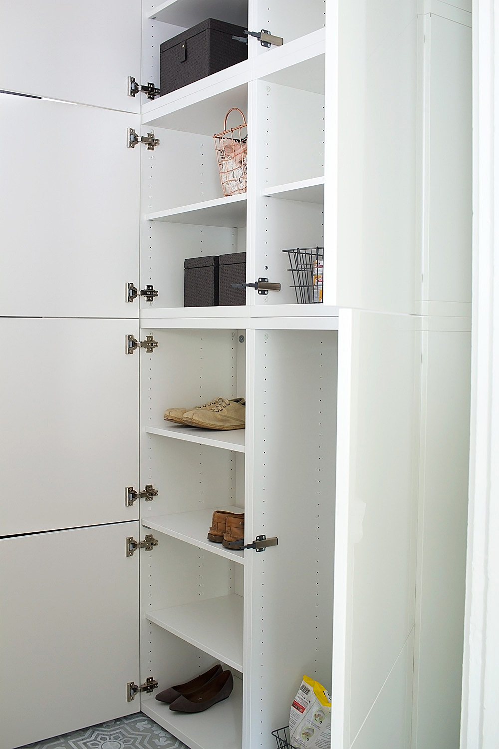 How to use IKEA BESTA cabinets to completely transform your entryway into a practical, organized, and inviting space.