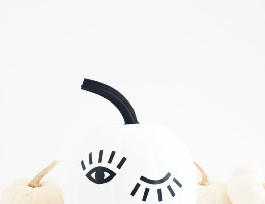 You can make this DIY winking eye pumpkin in just 30 minutes using black contact paper and a free printable template!